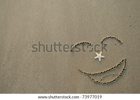 Handwrited face on the sand at the beach - stock photo