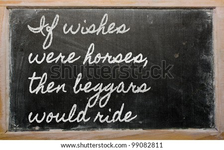 handwriting blackboard writings - If wishes were horses, then beggars would ride - stock photo
