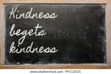 handwriting blackboard writings - Kindness begets kindness - stock photo