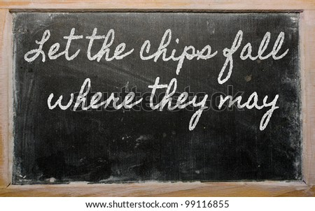 handwriting blackboard writings - Let the chips fall where they may - stock photo