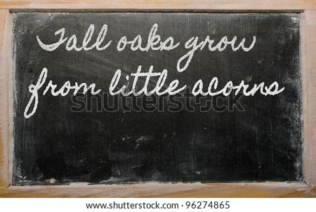 handwriting blackboard writings - Tall oaks grow from little acorns - stock photo