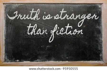 handwriting blackboard writings - Truth is stranger than fiction - stock photo