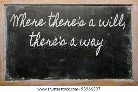 handwriting blackboard writings - Where there's a will, there's a way - stock photo