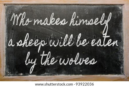 handwriting blackboard writings - Who makes himself a sheep will be eaten by the wolves - stock photo