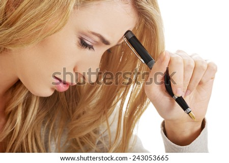 Handwriting, hand  writes with a pen in a notebook - stock photo