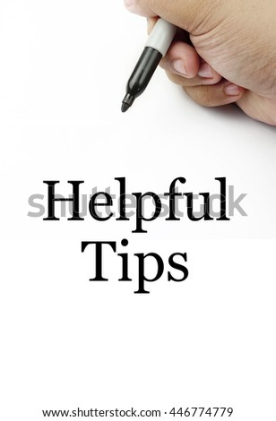 "Handwriting of ""helpful tips"" with the white background and hand using a marker."