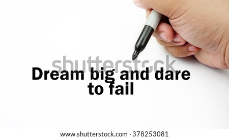 "Handwriting of inspirational motivation quotes ""Dream big and dare to fall"". This quotes use to motivate people to always strive for success."