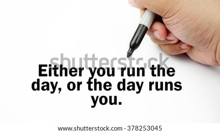 "Handwriting of inspirational motivation quotes ""Either you run the day, or the day runs you"". This quotes use to motivate people to always strive for success."