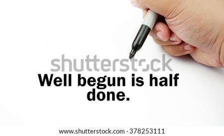 "Handwriting of inspirational motivation quotes ""Well begun is half done"". This quotes use to motivate people to always strive for success."