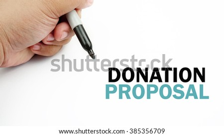 "Handwriting of word that related to business "" donation  proposal """