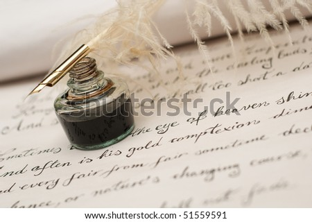 Handwriting poetry on old scroll, ink and quill pen in focus - stock photo