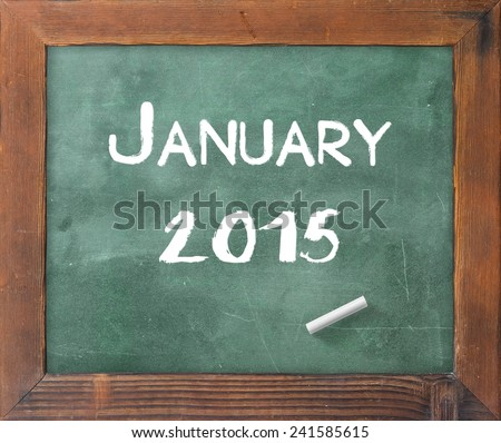 Handwriting text for JANUARY 2015 on green board. - stock photo