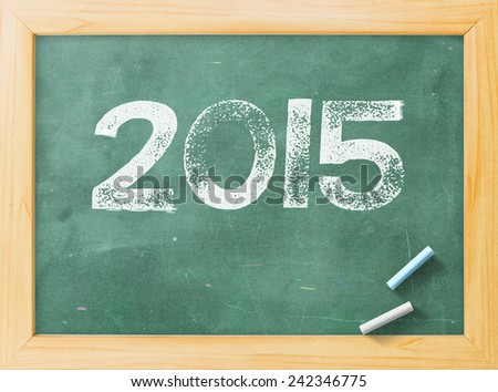 Handwriting text for 2015 on green board. - stock photo