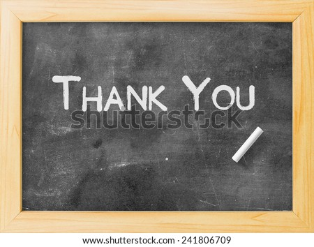 Handwriting text for THANK YOU on blackboard. - stock photo
