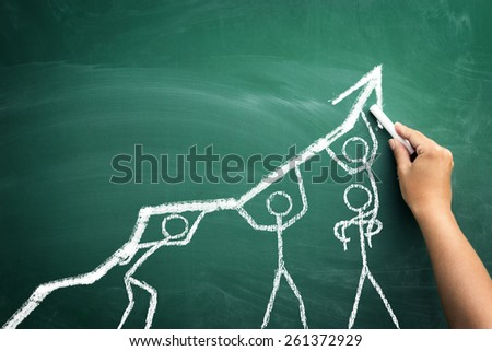 handwriting with chalk on blackboard team working together on grow business  - stock photo