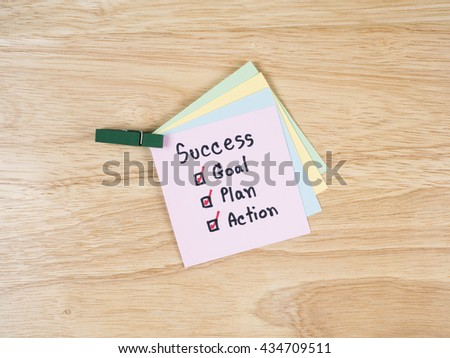 Handwriting word Success, Goal, Plan, Action on colorful notepaper with wood background (Business concept) - stock photo