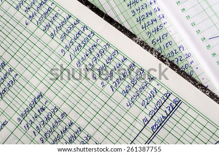 Handwritten accounting on the open pages of some old ledgers - stock photo