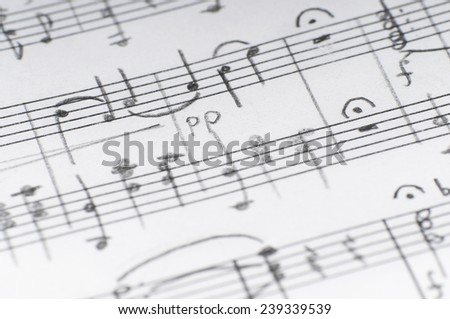 Handwritten musical notes, shallow DOF
