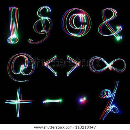 Handwritten neon light alphabets - symbols - stock photo
