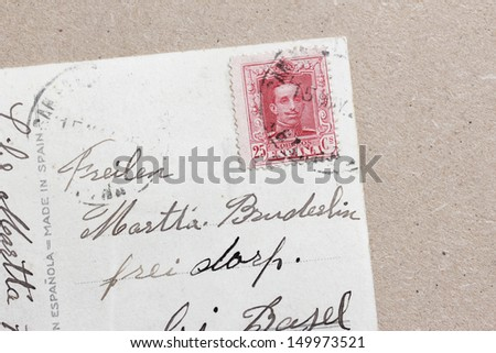 handwritten old postcard with stamp - stock photo