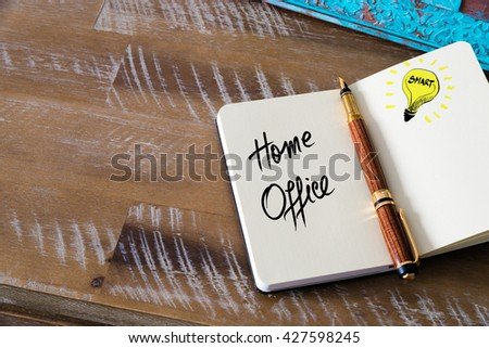 Handwritten text Home Office with fountain pen on notebook. Concept image with copy space available. - stock photo