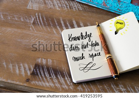 Handwritten text Knowledge does not take much space with fountain pen on notebook. Concept image with copy space available. - stock photo