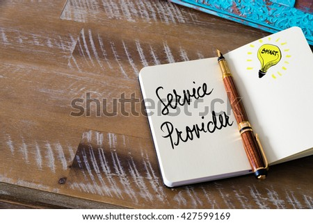 Handwritten text Service Provider with fountain pen on notebook. Concept image with copy space available. - stock photo