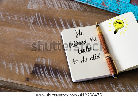 Handwritten text She believed she could, so she did with fountain pen on notebook. Concept image with copy space available. - stock photo