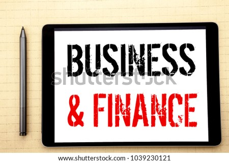 Handwritten text showing Business And Finance. Business concept writing for Company Strategy Written on tablet computer screen, white background in  office space view with pencil marker