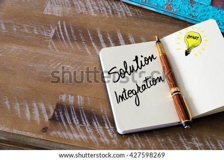 Handwritten text Solution Integration with fountain pen on notebook. Concept image with copy space available. - stock photo
