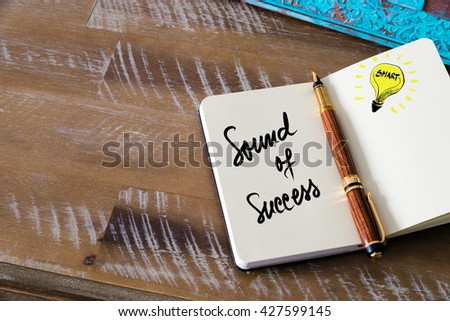 Handwritten text Sound Of Success with fountain pen on notebook. Concept image with copy space available. - stock photo