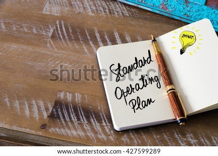 Handwritten text Standard Operating Plan with fountain pen on notebook. Concept image with copy space available. - stock photo