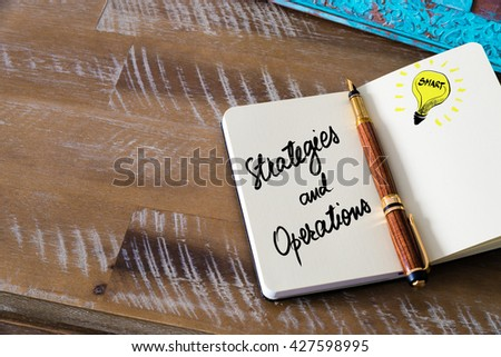 Handwritten text Strategies and Operations with fountain pen on notebook. Concept image with copy space available. - stock photo