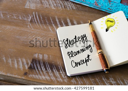 Handwritten text Strategy Planning Concept with fountain pen on notebook. Concept image with copy space available. - stock photo