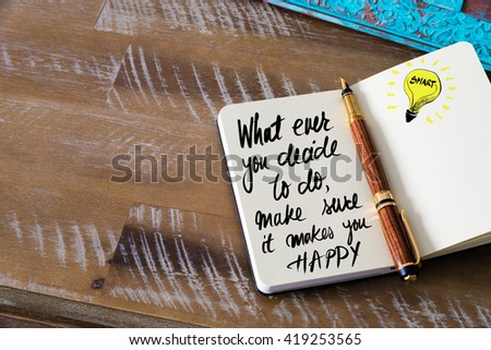 Handwritten text What ever you decide to do, make sure it makes you happy with fountain pen on notebook. Concept image with copy space available. - stock photo