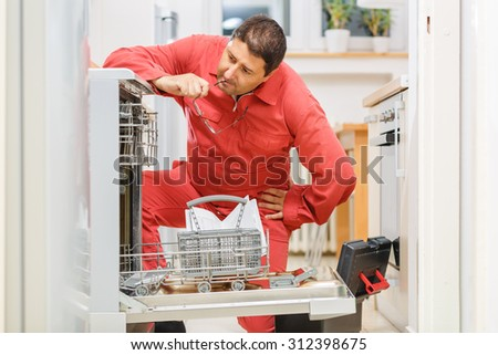 Handy man trying to figure out the problem with the dishwasher in the kitchen