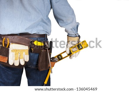 Handyman carpenter with tool belt - stock photo