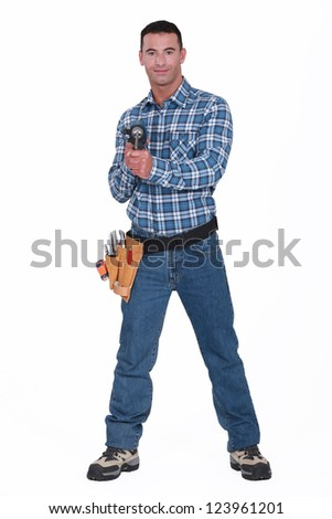 Handyman holding a cordless  powerdrill
