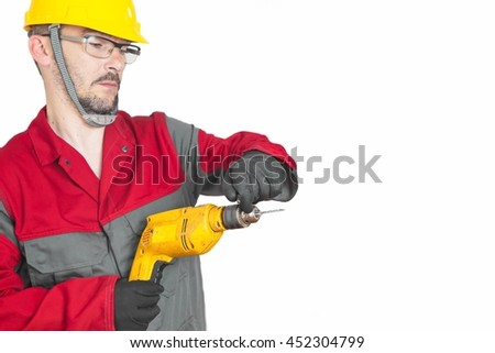 Handyman holding power drill on white