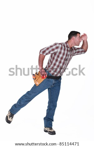 Handyman looking into the distance - stock photo