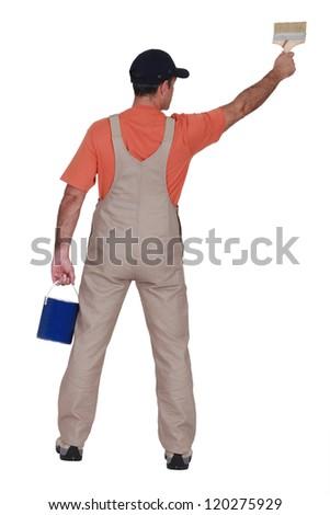 Handyman painting, back view - stock photo