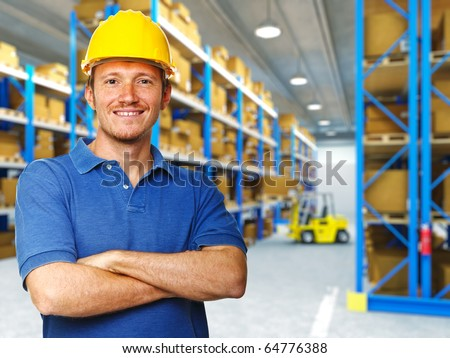 handyman portrait in 3d warehouse background - stock photo