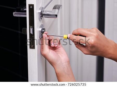 handyman repair the door lock in the room Man fixing lock with screwdriver Close & Handyman Repair Door Lock Room Man Stock Photo 726025735 ... pezcame.com
