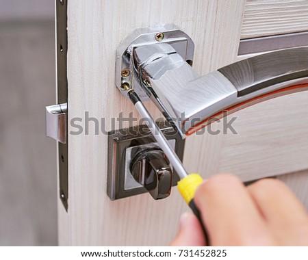 handyman repair the door lock in the room Man fixing lock with screwdriver Close & Handyman Repair Door Lock Room Man Stock Photo 726025771 ... pezcame.com
