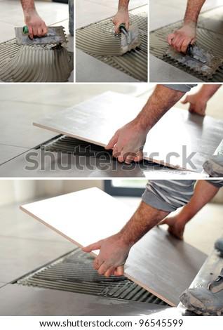 handyman spreading glue on the floor - stock photo