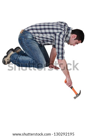 Handyman with a hammer - stock photo