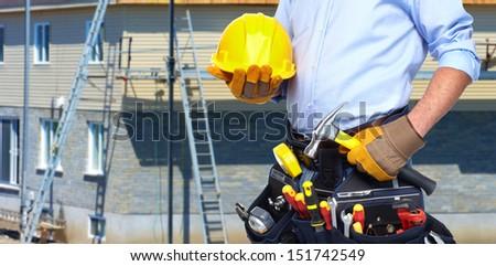 Handyman with a tool belt. House renovation service. - stock photo