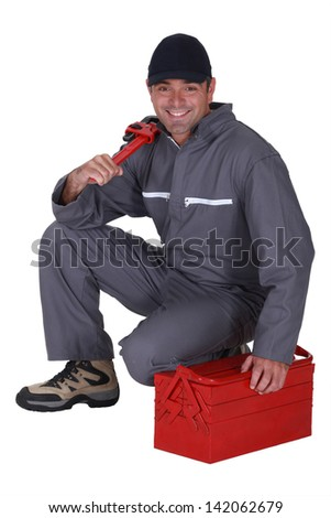 Handyman with a toolbox - stock photo