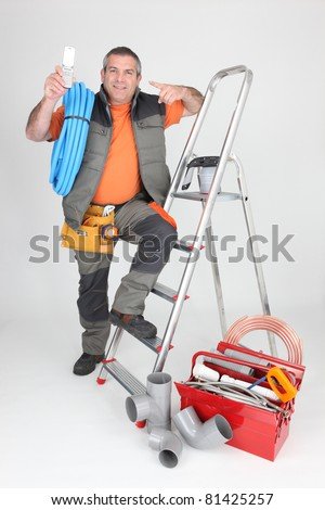 Handyman with a toolbox and cellphone - stock photo