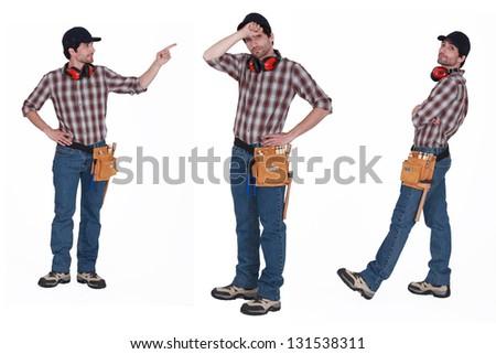 Handyman with ear muffs - stock photo